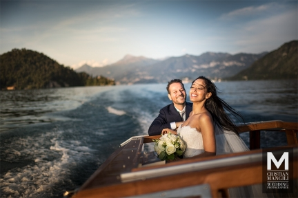 046 lake como wedding photography italy bride and groom on boat 1